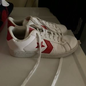 White converse sneakers with red accents